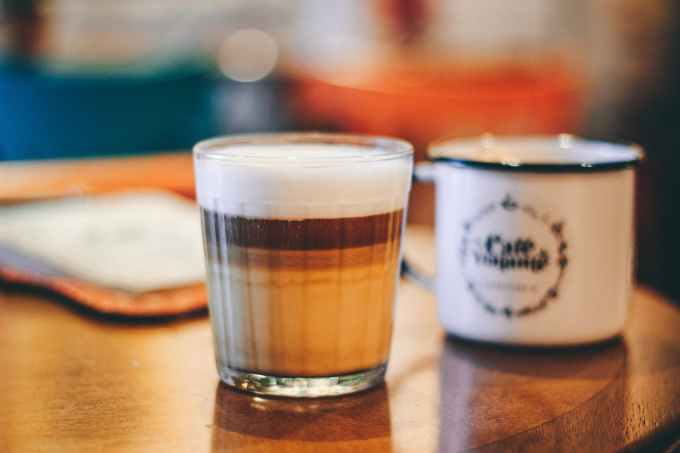 selective focus photography of cappuccino coffee